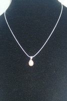 "Simple & elegant, singular drop cultured Pearl in dreamy cream/white, suspended from a .925 Sterling Silver bail, on a 18"" .925 Sterling Silver snake chain.  Think bride, bridesmaid or just for you, it goes with anything! Ultimate elegance!"