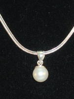 "Simple & elegant, singular nearly round cultured Pearl in beautiful cream/white, suspended from a .925 Sterling Silver bail, on a 18"" .925 Sterling Silver snake chain.  Dress up those jeans or give someone a gift, they will keep forever!"