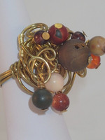 Stunning gold coloured wire ring, full of movement due to the Jasper,Druzy, Carnelian & Goldstone beads which are suspended from it.  Check out the geodoe...That Sunday walk, kicking leaves, then lunch in a nice pub....yes, it would look fab!