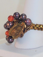 Chic Purple Pearl & Carnelian cluster ring, made in Antique Bronze wire.  Get the vintage feel with this stunning ring with twirls & flows of woven wire, enhanced only by the vibrant Orange & luxurious purple shades