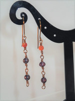 Elegant Purple Pearls & Carnelian earrings.  Achieve the vintage look with these lovely rosary style drop earrings, woven together with Antique Bronze wire.  Tickets for a concert? Don't forget these 4cm drop earrings!