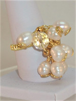 Real Pearls and Quartz size Q ring. A unique wedding day accessory, or for someone who just loves Pearls. This gold coloured ring is full of movement, it shimers and reflects the lovely lustres from the Pearls and faceted round Quarz. A fab ring