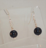 These Black Onyx and .925 Sterling Silver earrings are a must for any wardrobe. Stylish and understated enhanced by .925 Sterling Silver spacer beads. Picture this black jeans, white shirt and these wonderful earrings