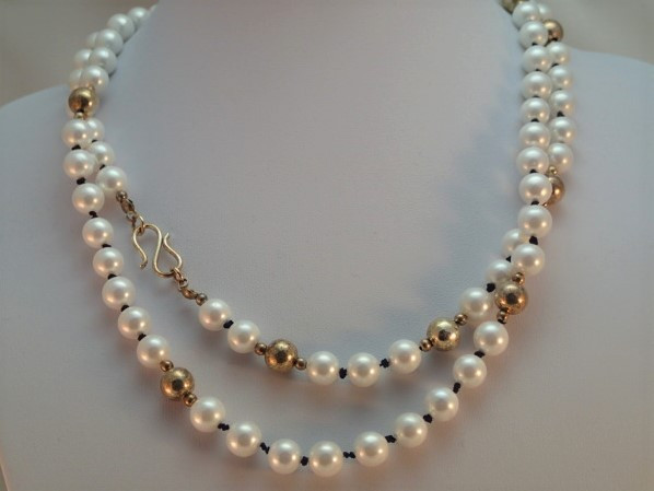 182f78f46 Contemporary styling with a hint of mottled warmth, from this deliberately tarnished  925 Sterling Silver and White Shell Pearl necklace, ...
