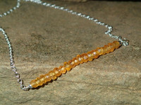 """Stunning 20"""" necklace with the most amazing vibrant orange colours.  Set centrally on a 925 Sterling Silver belcher/rolo chain with lobster clasp.  These 2x3mm approx. faceted gemstones are not for the faint hearted, as they really catch the eye!"""