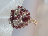 A superb silver plated woven cluster ring, complete with magnificent dark red faceted Garnets. This delicately wired piece is every part an incredible ring, and looks stunning on and off the finger, in size M this is a real special unique gift...