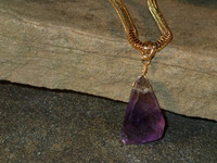 """The richness of the purple Amethyst and golden tones of the Citrine, magically combined by mother nature as an Ametrine. This substantial piece (25x15x11mm) is hung from a 3mm 20"""" gold filled snake chain...a really lovely piece!"""