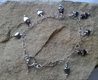 Haematite Heart and Ruby bracelet on 925 Sterling Silver heart shaped chain with bar clasp