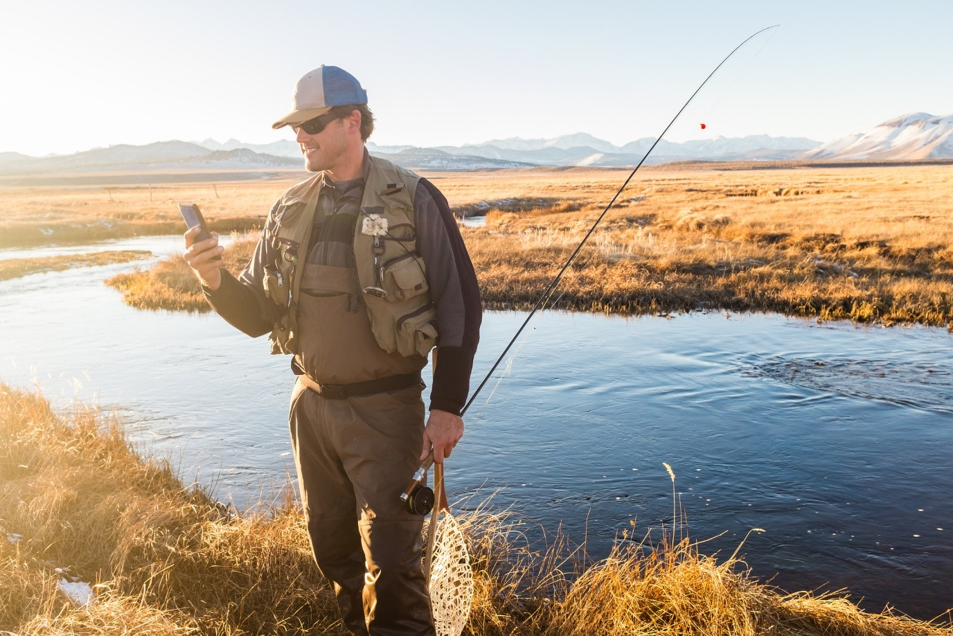 Fisherman using mobile phone