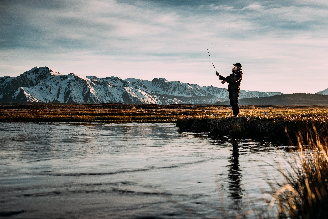 Man Fishing in Cold Winter