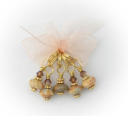 Look for warm golds and reds in these 8mm rondels, with Swarovski crystals set in 14K gold. (5) per set