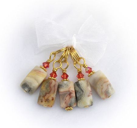 Warm colors in this favorite nugget shape just seem to work so well. Not too heavy or too light, these are a beautiful all around set. Gold with Swarovski crystals. (5) per set.