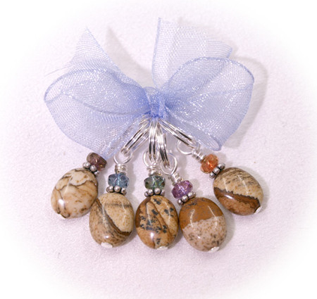 Like the desert landscape, faceted and light. Set in Sterling Silver with Czech crystals. (5) per set