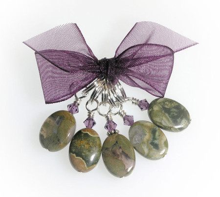 Smooth oval disks of greens, translucent, and cantaloupe colors. Set in Sterling Silver with Swarovski crystals. (5) per set