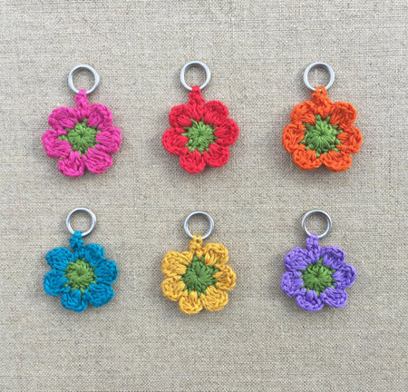 Cute crocheted markers on closed metal ring to mark your stitch. Also great as creative embellishments. Set of 6. 5/16 inch inner ring diameter.