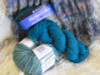 Each Uluru Scarf Kit comes complete with 1 skein of Uluru yarn for the stockinette segments and a coordinated skein for the linen stitch segments of the scarf.