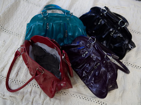 Back row: Caribbean blue, black.  Front row: Red, eggplant.