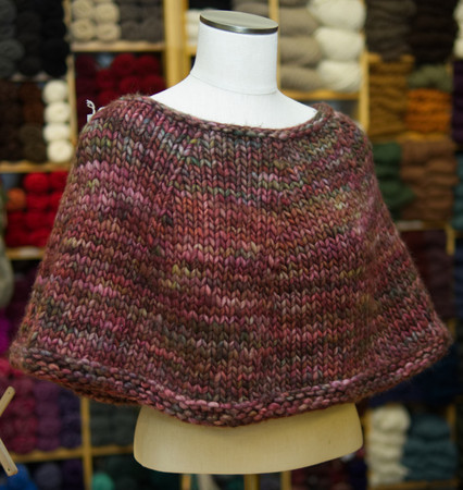 The pattern to create this gorgeous ponchetta is yours FREE with a purchase of the Malabrigo Rasta or Brown Sheep Burly Spun yarn you use to create it!
