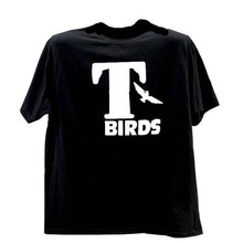 Thunderbird or T bird tee shirts are sold at a very affordable price. Sizes from Youth X-small to Adult 3X are available for purchase on this website. A silk screen print of the logo for TBirds is on the front of the tee in white lettering on a black tee. They are great for group events, sports teams, sock hops, dances, 50s theme parties, and so much more.Front view shown here.