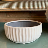 White glazed ceramic planter.