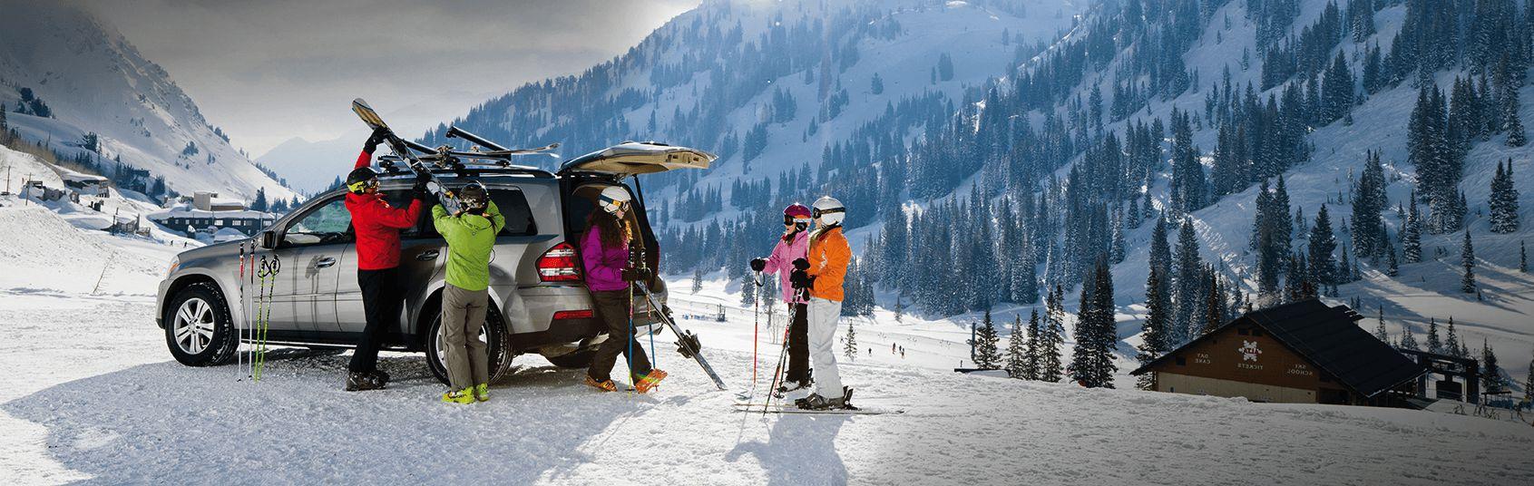 loading-skis-onto-ski-rack.jpg