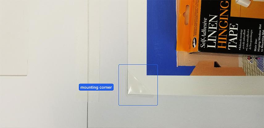 mount corner holding artwork - mat board center