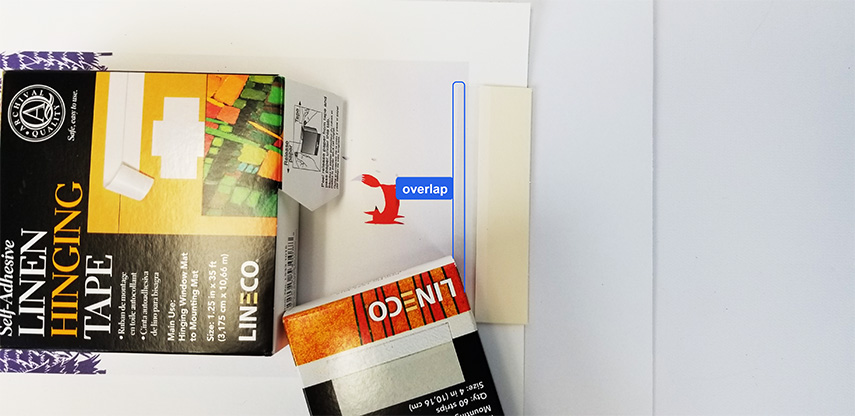 mount strips overlapping artwork - mat board center