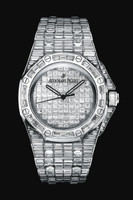 Watches Audemars Piguet Royal Oak Offshore Baguette 15130BC.ZZ.8042BC.01 issued in the case of 18k white gold, size 42 x 54 mm and water resistant to 20 m with a bezel of the white baguette diamonds, encrusted hull white baguette diamonds, total weight of 456, and white baguette diamonds - 47.75 ct. Inside the case is set automatic movement, caliber AR 2325.  The dial with white baguette diamonds displays hours, minutes, seconds. Power reserve 40 hours. Watches are equipped with a bracelet made of white gold 18k, inlaid white baguette diamonds.