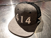 414 Milwaukee Trucker hat. Grey active heather crown with black mesh body. Pearl white 414 numbers with Too Much Metal logo on left side. Perfect breathable for the summer.