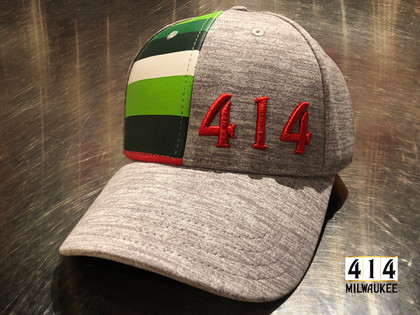 Proud to announce the 414 Milwaukee Irish Rainbow hat. This is a tribute cap to the proud history of the Milwaukee Bucks. The Irish rainbow is a retro design feature running up and down the sides of the home and away uniform of the 1980s. Be proud of the city of Milwaukee and its basketball team. Stretch fit, snap back with curved brim Athletic heather bone breathable 100% cotton fabric.