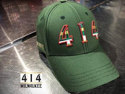 This is a tribute hat to the proud history of the Milwaukee Bucks. The Irish rainbow is a retro design feature running up and down the sides of the home and away uniform of the 1980s. Be proud of the city of Milwaukee and its basketball team. Adjustable, snap back hat. 100% Oxford lightweigh cotton.