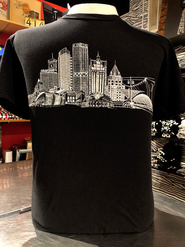 Black and White Milwaukee Skyline t-shirt featuring, US Bank, NM Tower, Fiserv Forum, UW-Milwaukee Panther Arena, Sydney HIH, Miller Park, Summerfest, Eagles Ballroom, Mitchel Park Domes, Milwaukee Art Museum, 100 East Building, Milwaukee Center, Gas Light Building, Quarels and Brady tower, Rockwell, Allen Bradley, Polish Moon, and Discovery World. 100% vintage soft cotton.