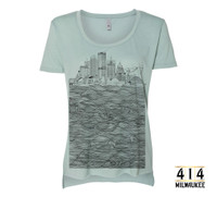 Mint green Milwaukee skyline t-shirt featuring US Bank, NM Tower, Fiserv Forum, UW-Milwaukee Panther Arena, Mitchel Park Domes, Milwaukee Art Museum, 100 East Building, Milwaukee Center, Gas Light Building, Quarels and Brady tower, Rockwell, Allen Bradley, Polish Moon, and Discovery World. Tri-blend shirt vintage soft unisex t-shirt.  3.5 oz., 65% Poly/ 35% Combed Ring-Spun Cotton, 40 single. 1x1 baby rib. Hemmed sleeve. Side seamed. Raw edge, exaggerated tail drop hem.