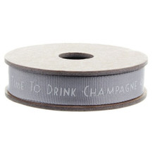 """High quality ribbon to wrap that special gift.    The words """"Time to Drink Champagne and Dance on the Table"""" running along the middle in white writing, the ribbon it's grey in colour.   Add a length of this 3m-long ribbon to a wrapped present, great for Wedding, Christmas & General gifts or just as a decorative touch around the house or for craft projects."""