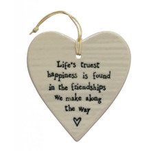Life's Truest Happiness Porcelain Heart  This white porcelain heart is a beautiful gift or decoration for anywhere around the home. It has a string attached so it can be hung from a wall, door or  display unit.  A lovely message that will make you or your friend smile each time you walk past it. This porcelain white heart will give your home a welcoming feel.  The heart reads: 'Life's truest happiness is found in the friendships we make along the way'.    Measures 8.5cm wide and 9cm long