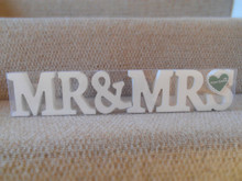 A beautiful set of 'Mr & Mrs' letters.  Great as decoration for a wedding to compliment your big day.  A lovely gift for an anniversary or accessory for your home.  They are free standing and finished in white, a beautiful and original gift idea.  made from:  Wood  dimensions:  Size: h8.5 x d2cm