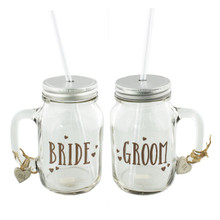 Love Story Mason Jar Drinking Glasses Set 2 'Bride & Groom'  Beautiful Mason Jars for the special couple. Dimensions:  H:23 W:12 D:9 cm