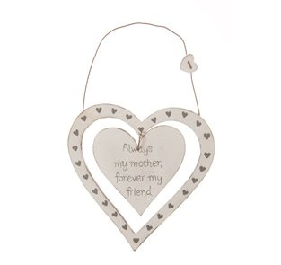 A newa lovely cream wooden plaque made up of a thin heart, patterned with tiny hearts, inside which is a solid heart displaying the words 'always my mother forever my friend'. On the wooden hanging wire sits another small heart. A delightful little gift for your daughter at any time of year. This charming item is from the vintage range, which comes in a distressed shabby chic finish. Each one of these delightful items has a slightly different finish and would look very attractive around the home. The heart measures approximately 13cm x 13cm with a hanging length of 19cm.