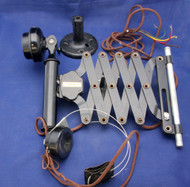 Scissors mount candlestick.  Note headset earpiece below and spindle mount above