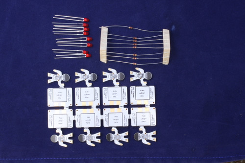 Kit includes 8 snap-apart flagmen, 8 1K ohm 1/8 watt resistors, 8 red LEDs and 8 weights