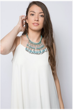 Ryleigh Beaded Bib Crystal beaded statement necklace with folded tassels. Length: 17 in. / 43 cm.  Extension: 3.25 in. / 8.2 cm.  Drop: 4 in. / 10 cm.