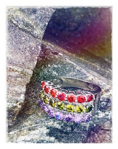 Isn't there always a rainbow after the rain?  We call this one our rainbow. It is brilliant with color and archs in that fashion of a rainbow. it's a  Round Cut Amethyst & Garnet & Peridot Gemstone Silver ring that can be worn on any finger .let it bring you light and happiness each time you were it.