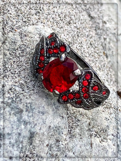 Stormy nights This is a red ruby Garnet 18KT Black Gold Filled ring. If this just doesn't make you feel like a princess on a ship with Jack Sparrow! ( a.k.a. Johnny Depp wink wink)