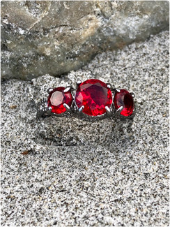 The Princess Elizabeth Ring , we named her after Elizabeth in Pirates of the Caribbean Stunning Ruby Sapphire CZ 10KT Black Gold Filled . A slight take on the Stormi nights ring. Pick your fancy! All POMP Beach rings are only $28!