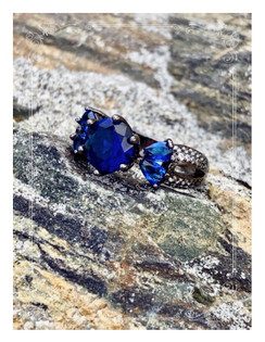 Winter in Maine. Our beaches are just as pretty in the off season. Winter wonderland in fact, when the snow hits. The beaches are prestigious and magnificent. I see it all in this ring.  Sapphire 14KT Black Gold Filled 925 sterling silver ring.