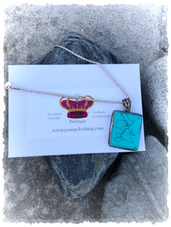 Turquoise pendant necklace includes sterling silver chain approx 18' chain. Hand designed.