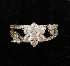 Size 6.5 Floral White Sapphire ring.  Delicate but very distinct .