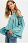 "- Lustrous sage silky ruffled off the shoulder top - Ruffled on chest - Adjustable tie shoulder strings  - Long bell sleeves - Model is 5' 8.5"" 31.5-24-34 and wearing a size Small"