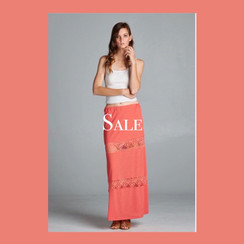 Coral Maxi skirt with lace trim. Crinkle knit maxi skirt with crochet lace insets. Miniskirt lining. Elasticized waistband. ON SALE! FREE SHIPPING!