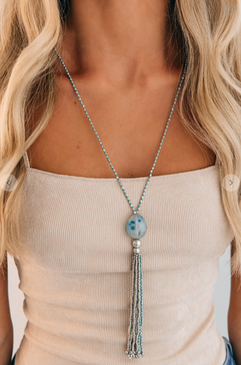 "Look at this gorgeous Boho piece just in! Here's the details  Color: Silver/Blue Beaded Detail Charm Detail Tassel Detail Stone Detail Stones May Vary 21"" Drop 29.5"" Chain Length  Composition: Iron Brass Stone"